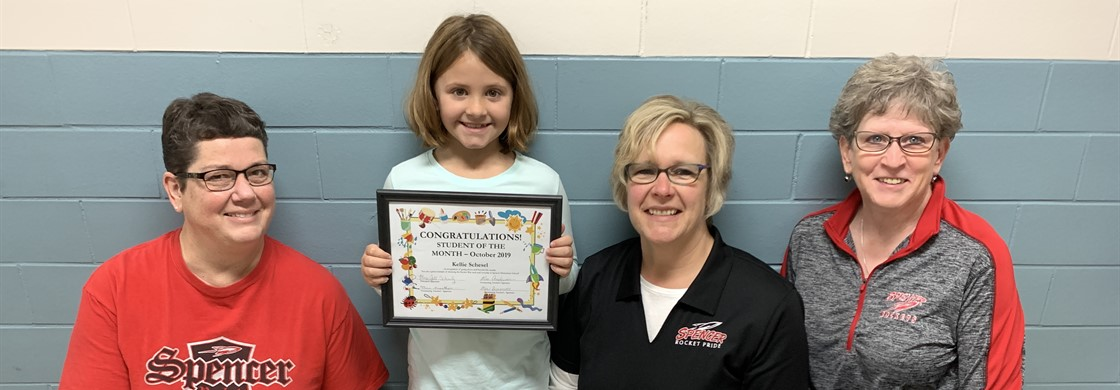 October Student of the Month with her teachers