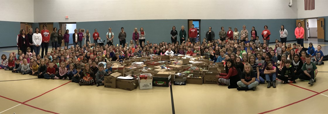Elementary Students with Over 3,000 items Brought in for the Food Drive!!