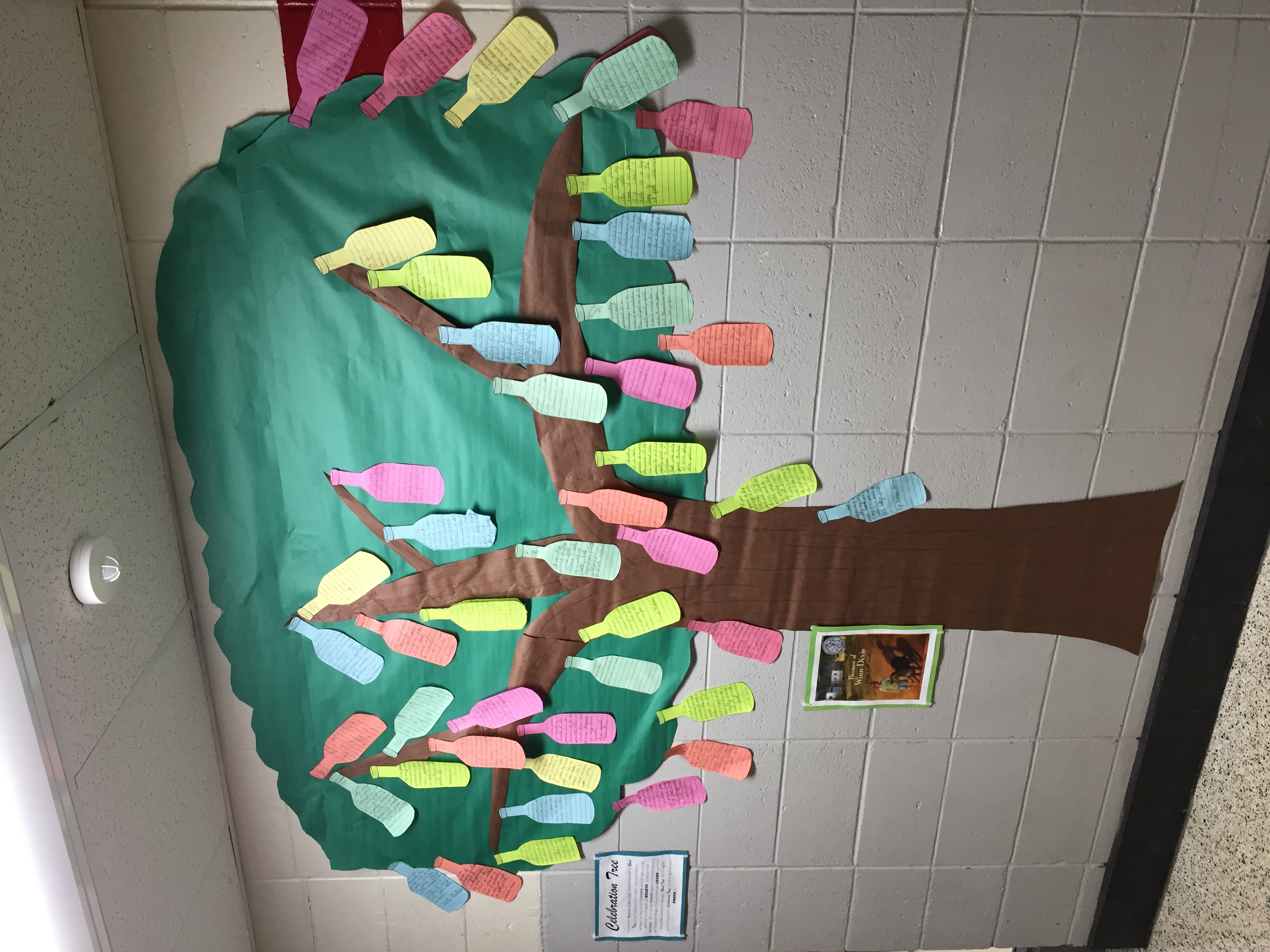 "Check out our ""Celebration Tree"" filled with bottles that represent accomplishments we are PROUD of!"